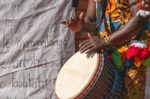 drummer walks past the words for tutira mai nga iwi