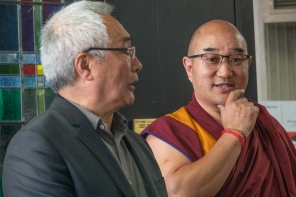 Geshe/Monk and interpreter take turns speaking
