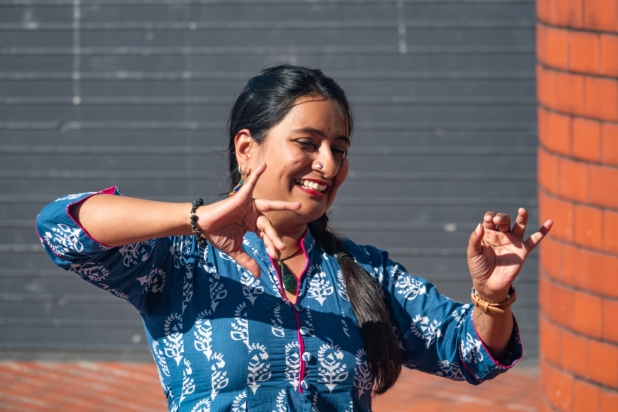 Swaroopa in a blue and white patterned dress embodies characters in this dance